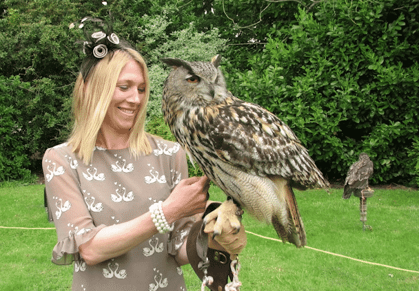 owl Elvis with woman at a wedding event